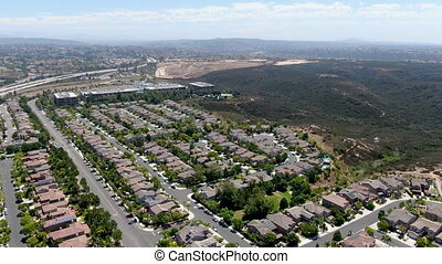 Aerial view of Torrey Santa Fe, middle class subdivision neighborhood with residential villas in San Diego County, California, USA.