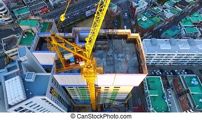 Aerial View of Tower crane On the Construction site , busan South, Korea Asia