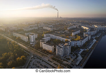 Aerial view of town in autumn at sunset. Energodar, Ukraine. The satellite city of Europe's most atomic power station. Aerial photography. Top view.