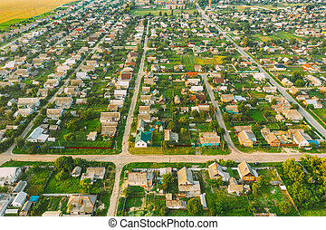 Aerial View Of Town Village Cityscape Skyline In Summer Day. Residential District, Houses And Garden Beds In Bird's-eye View.