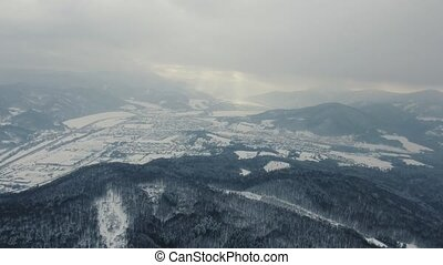 Aerial view of town with hills in winter. - Aerial view of a...