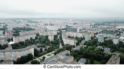 Aerial view of town with socialist soviet style of building at cloudy day. Buildings were built in the Soviet Union. The architecture looks like most post-soviet commuter towns