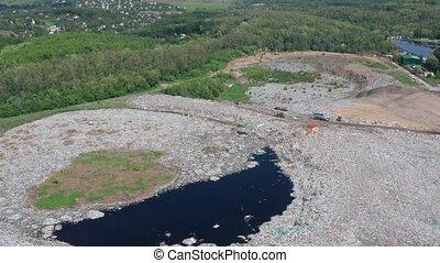 Aerial view of toxic lake in rural garbage dump - Drone...