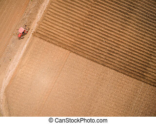 Aerial view of tractor on Prepare a field
