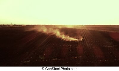 Aerial view of tractor plowing the ground - Aerial view of...