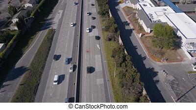 Aerial view of traffic on freeway, 4K video