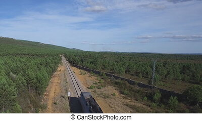 Aerial view of train in the country, heading forward