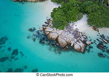 Aerial view of tropical beach with crystal clear sea water