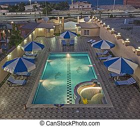 Aerial view of tropical holiday villa swimming pool atnight