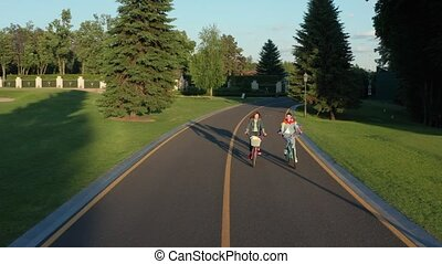 Aerial view of two lesbians riding bikes in park - Drone...