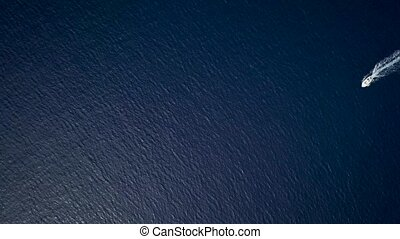 Aerial view of two motor boats crossing the sea navigating...