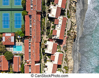 Aerial view of typical south california community condo with tennis court