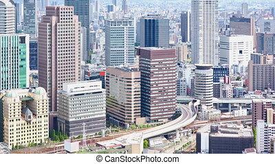 aerial view of Umeda District, Osaka, Japan - timelapse of...