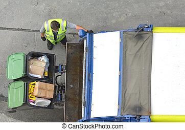 Garbage man loading garbage truck - Aerial view of ...