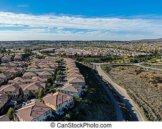 Aerial view of upper middle class neighborhood with identical residential subdivision house