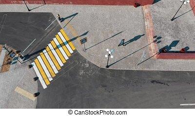 Aerial view of urban streets. Crosswalk. A man walking. Wide...