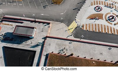 Aerial view of urban streets. Three parkour men walking....