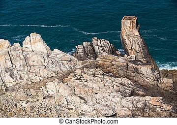 Aerial view of Ushant island rocky coastline at Creach point, Brittany, France