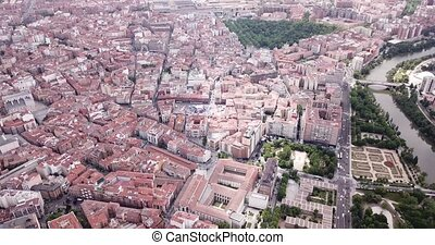 Panoramic aerial view of district of Valladolid with modern apartment buildings and river