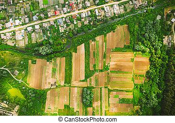 Aerial View Of Vegetable Gardens In Small Town Or Village. Skyline In Summer Evening. Village Garden Beds In Bird's-eye View
