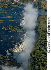 Aerial view of Victoria Falls with spray