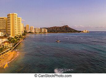 Aerial view of Waikiki beach towards Diamond Head at sunset