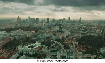 Aerial view of Warsaw cityscape on a partially cloudy day, Poland