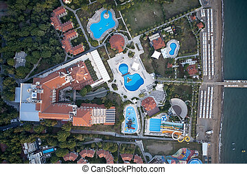 Aerial view of water park and coastline of resort hotel.