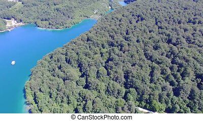 Aerial view of waterfalls and lakes in Plitvice National Park.