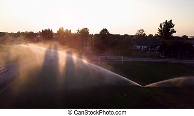 Aerial view of watering the lawn of a football field