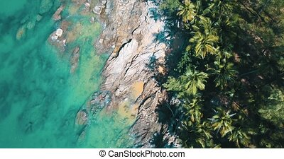 Aerial view of waves crushing on the rocks