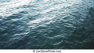 Aerial view of waves on the water surface