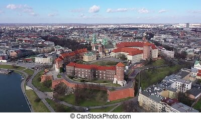 View from above of fortified architectural complex of Wawel Castle and Archcathedral Basilica on banks of Vistula river in springtime, Krakow, Poland
