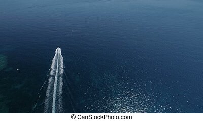 aerial view of white boat in Adriatic sea, Montenegro