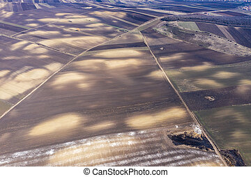 Aerial view of white chemical fertilizer, manure on the ground