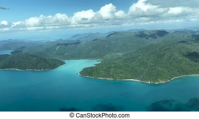 Aerial view of Whitsunday Islands archipelago from a flying airplane.