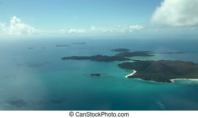 Aerial view of Whitsunday Islands archipelago from a flying airplane