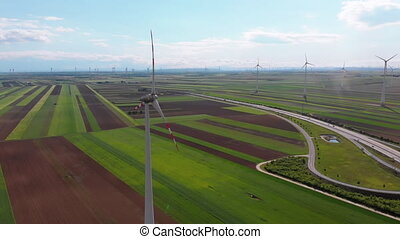 Aerial view of Wind Turbines Farm and Agricultural Fields....