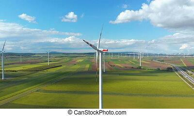Aerial view of Wind Turbines Farm in Field. Austria. Drone...