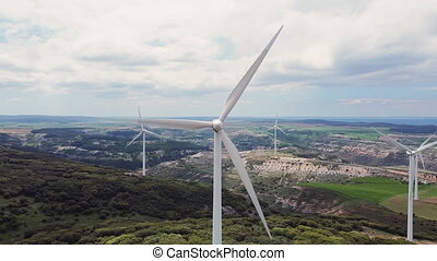 Aerial view of windmills farm for clean energy production on...