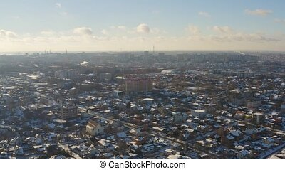 Aerial view of winter cityscape in Dnipro city. 4K footage...