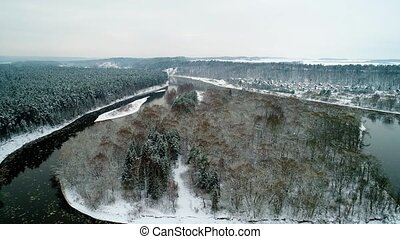 aerial view of winter forest and river