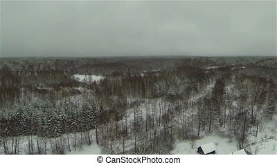 Aerial view of  winter forest village, snow - snowstorm, russia, bad weather