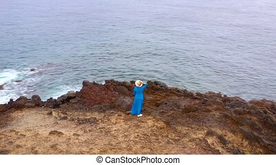 Aerial view of woman in a beautiful blue dress and hat...