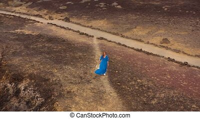 Aerial view of woman in a beautiful blue dress and...