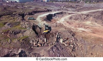 Aerial view of working excavator in the opencast mine....