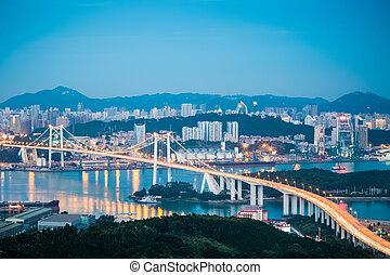 aerial view of xiamen haicang bridge in nightfall