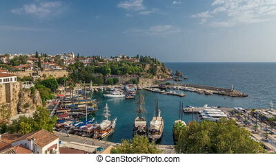 "Aerial view of yacht harbor and red house roofs in ""Old town"" timelapse Antalya, Turkey."