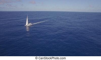Aerial view of yacht sailing in sea or ocean