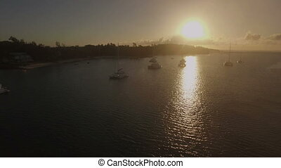 Aerial view of yachts in bay of Mauritius at sunset - Flying...